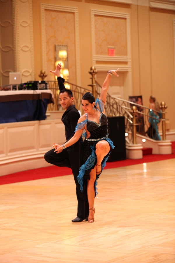image of man and woman completing a ballroom dancing routine