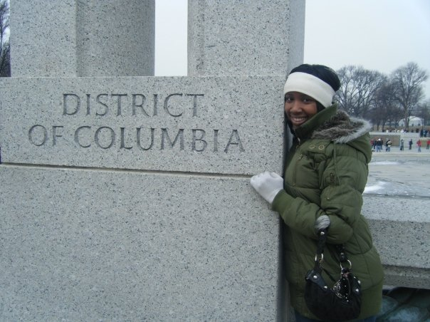 Image of young lady standing next to monument in Washington DC.